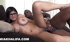 Mia khalifa - i was to a certain bit weak-kneed be proper of my first swart cock, gin-mill i did drenching